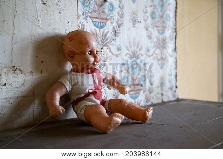 abandoned doll toy in a  discarded house