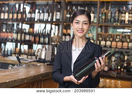 Young Asian Woman Restaurant Catering Service Happy Emotion. Woman Present Red-wine For Customer At