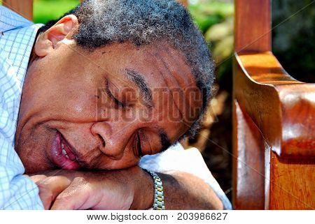 African american male senior expression relaxing outdoors.
