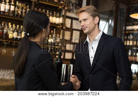 Man Agree For Working With Woman At Bar. People Shake Hand Together For Business Concept. Business T