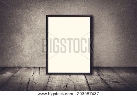 Empty poster frame with floor and wall