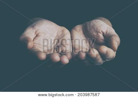 Open hands low key image. Help need charity concept.