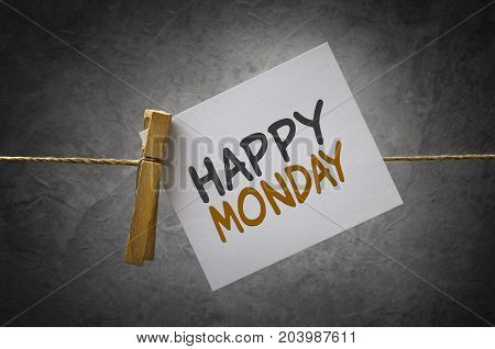 Happy monday paper note attach to rope with clothes pins on dark background