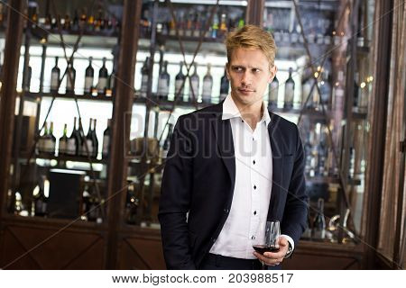 Portrait Of A Handsome Businessman Standing In Restaurant, Man With Business Concept.