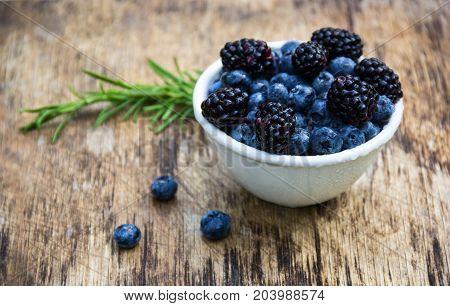 Juicy berries of blueberries and blackberries. Natural sweets. Useful berries.