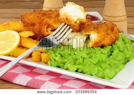 Fish and chips meal with mushy peas