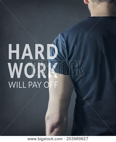 Back view of strong motivated man. Sports fitness club gym training lifestyle motivational poster concept.