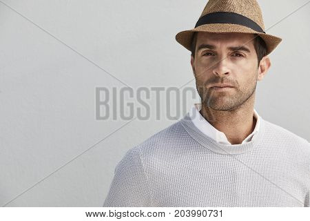 Serious dude in hat looking at camera