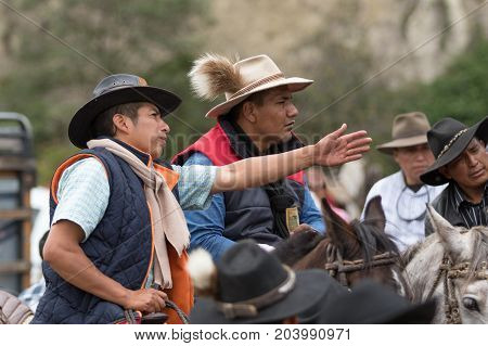 May 27 2017 Sangolqui Ecuador: cowboys at a rural rodeo in the Andes area having a discussion