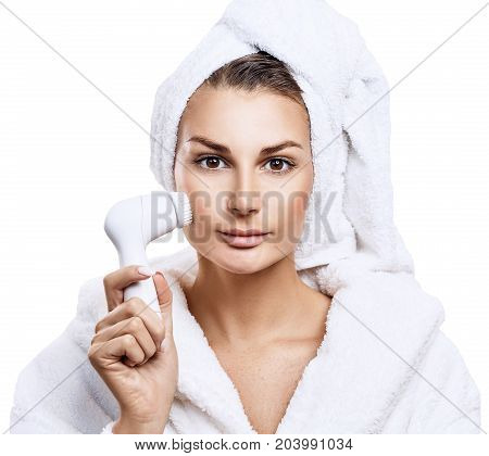 Sensual woman with cleansing brush. Woman cleanses the face skin.