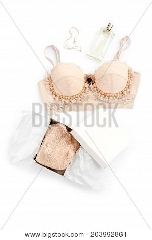 Glamorous stylish sexy lace lingerie with woman accessories on white background. Woman lace bra with perfume, flat lay, top view. Shopping and fashion concept, textile, underwear