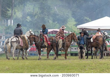 May 27 2017 Sangolqui Ecuador: cowboys gathering in field before a rural rodeo in the Andes