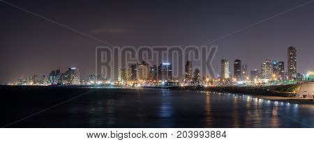 Tel Aviv-Yafo Israel September 08 2017 : Panoramic view of Tel Aviv city and bay at night. View from promenade of Old City Yafo Israel