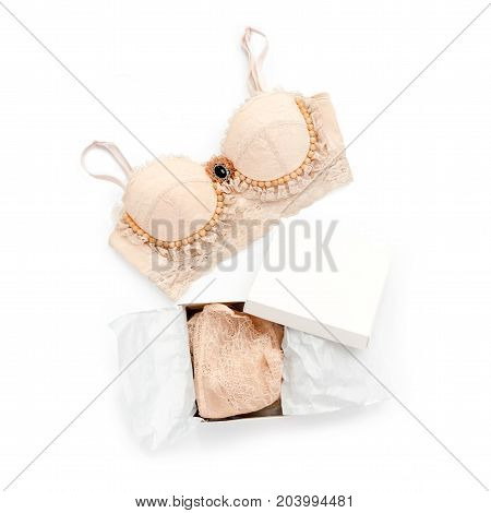 Glamorous stylish sexy lace lingerie with woman accessories on white background. Woman lace bra with giftbox, flat lay, top view. Shopping and fashion concept, textile, underwear