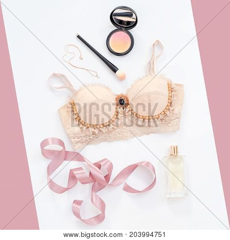Glamorous stylish sexy lace lingerie with woman accessories on white background. Woman lace bra with perfume and make up items, flat lay, top view. Shopping and fashion concept, textile, underwear