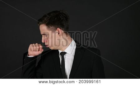 Cough Coughing Businessman Dark Black Background in Studio
