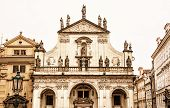 Saint Salvator church in Prague Czech republic. Architectural scene. Travel destination. Yellow photo filter. poster