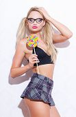 Sexy smart blonde woman with pigtails holding lollipop closed eyes desire poster