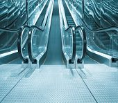 contemporary moving escalator stairs inside business blue hall poster
