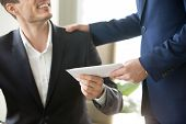 Company leader giving money bonus in paper envelope to happy smiling office worker, congratulating employee with increasing of salary or promotion, thanking for successes in work. Close up concept poster