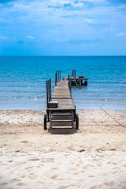 Tropical lonely beach deck under blue sky