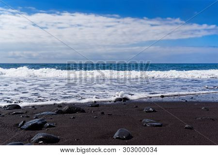 Panoramic View On A Black Sand Beach Against Blue Sky. Praia Formosa Beach In Funchal On Portuguese