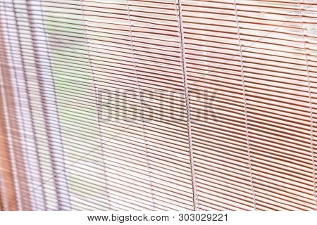 Straw Blinds, Jalousie For Background. Natural Blinds. Straw Twigs Background Texture Suitable For A