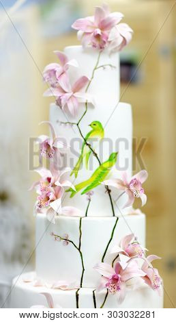 Traditional Anniversary/wedding Multi-layer Cake. Beautiful Delicious Sweet Dessert Decorated With F