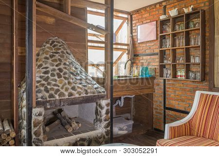 Fireplace And Arm Chair And Glass Shelf In Country Loft Interior Design Room. Interior Design Room I