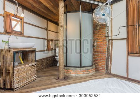 Toilet And Bed In Country Interior Design Room. Interior Design Room Include Glass Bathroom And Sink