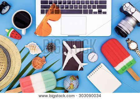 poster of Summer concept on blue blackground with laptop, flat lay of modern workplace with laptop on blue background, Outfit and accessories of traveler on blue background with copy space, Travel concept. top view of Traveler's accessories, blue desk office w