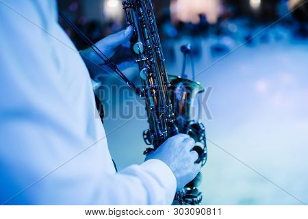 Musician Playing Saxophone Indoors.musician Playing Saxophone Close Up