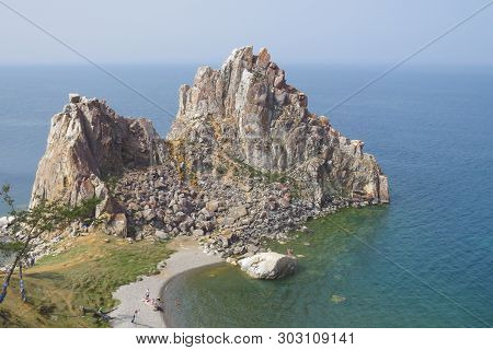 Lake Baikal. Olkhon Island. Cape Burkhan. Khuzhir Village. View Of The Rock Shamanka.