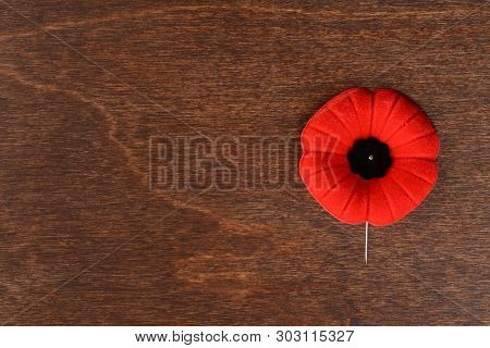 Top View Remembrance Day Poppy On Wood Table