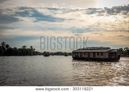 Houseboats In Backwater With Blue Sky And White Clouds Image Is Taken At Alleppey Kerala India. It I