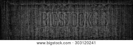 Old Black Concrete Wall Wide Texture. Dark Gray Cement Gloomy Background