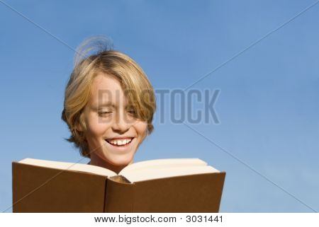 Child Reading Book Or Bible