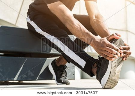 Athletic young afroamerican runner doing warm up on the promenade. Black Male running on outdoors. Healthy lifestyle concept. poster