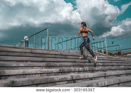 Athlete Girl Runs Jump Sports Jogging Training Summer City. Headphones Telephone. Concept Fitness Fr