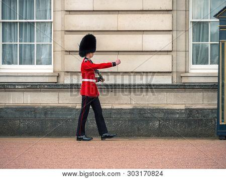 London, Uk - April, 2019: Sentry On Duty At Buckingham Palace. English Guard Patrolling In London. S