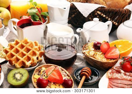 Huge Healthy Breakfast On Table With Coffee, Orange Juice, Fruits, Waffles And Croissants. Good Morn