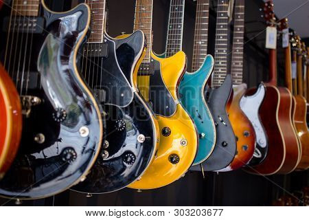 Row Of Electric Guitars In A Music Instruments Shop. Parts Of Guitar, Guitar Body