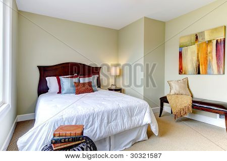 Bedroom With White Bedding, Green Walls And Nice Decor.