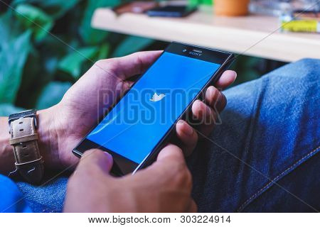 Chiang Mai, Thailand - Feb 13,2018:man Holding A Sony Xperia Xzs Mobile Phone With Twitter App.twitt