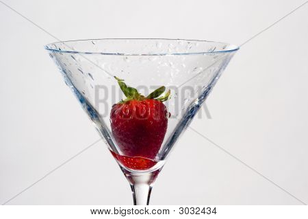 Wet Strawberry In Martini Glass On White