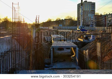 Concrete formwork in the pit in the construction of an underground passage in the subway poster