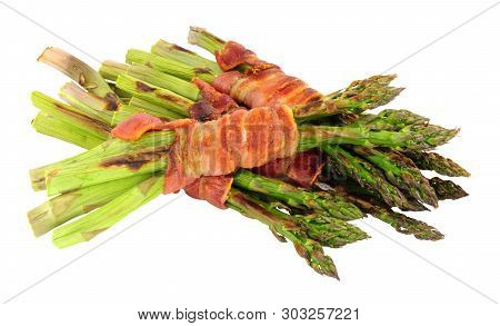 Grilled Asparagus Wrapped In Smoked Streaky Bacon Rashers Isolated On A White Background
