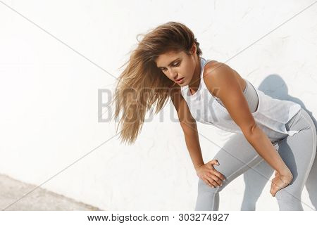 Tired Gasping Young Motivated Sporty Sportswoman Bending Forward Breathing Heavily After Running, Mo