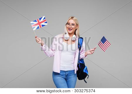 Education, Foreign Language Translator, English, Student - Smiling Blond Woman In Headphones Holding