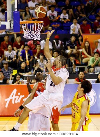 KUALA LUMPUR - FEB 19: Malaysian Dragons' Brian Williams (33) goes to the hoop against the Singapore Slingers at the ASEAN Basketball League match on Feb 19, 2012 in Kuala Lumpur, Malaysia.  Dragons won 86-71.